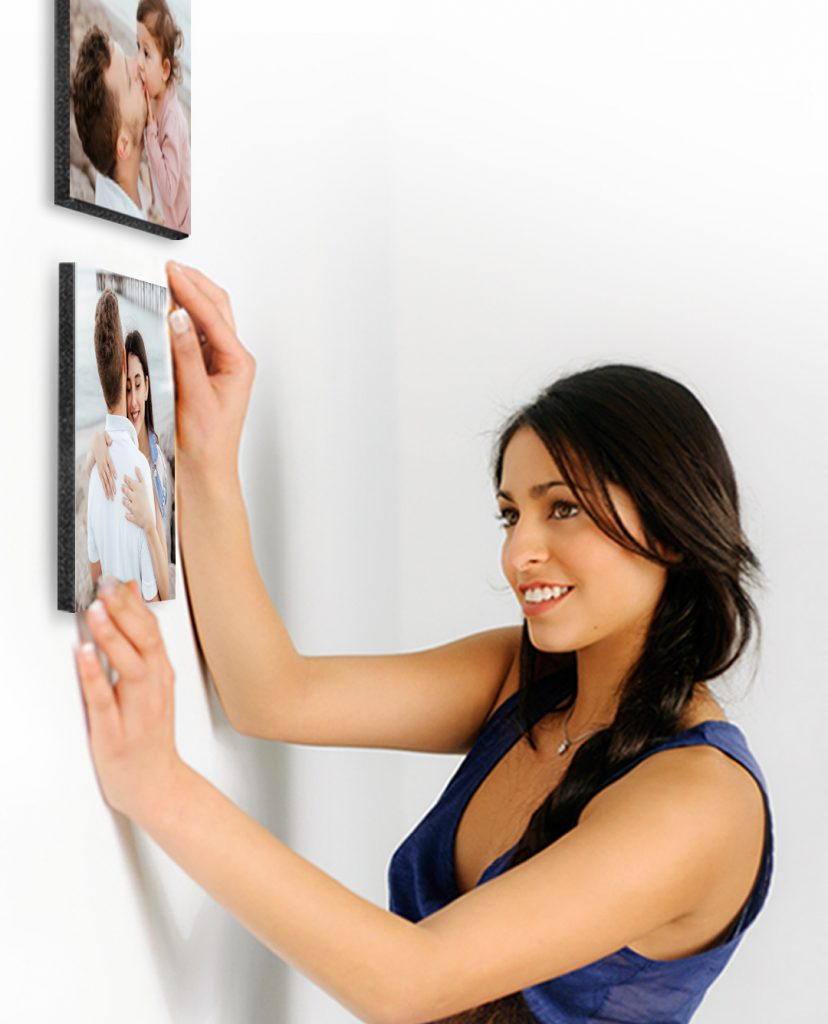 Woman hanging family picture tiles